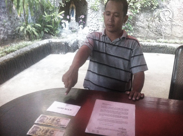 VOTE BUYING. PO1 Hefner Doble points at the money he allegedly received from a mayoral candidate in Southern Leyte. Photo by Voltaire Tupaz