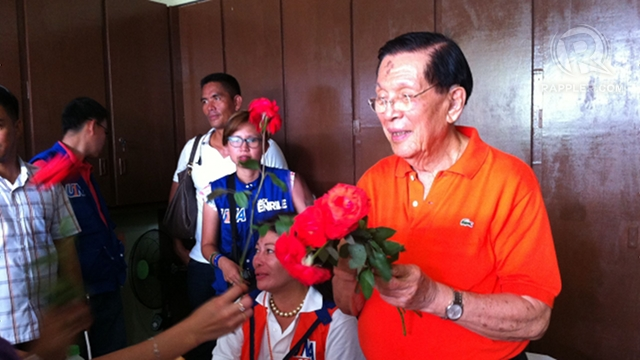 """THRIVING UNA. Boholanos give Senate President Juan Ponce Enrile flowers for his 89th birthday. Enrile says his birthday wish is """"for UNA to thrive."""" Photo by Ayee Macaraig"""