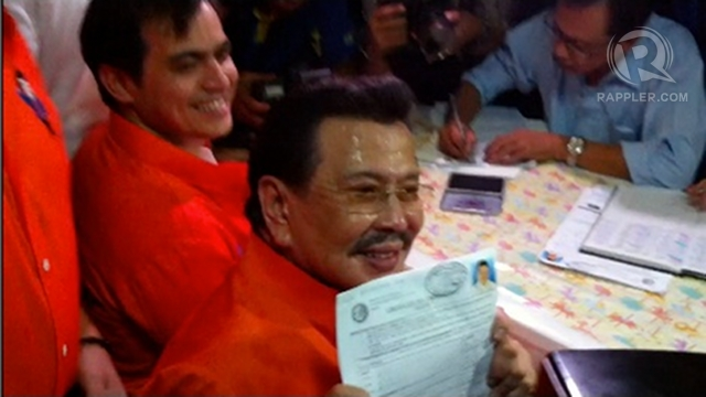 MAYOR AGAIN? Far from retiring, former President Joseph Estrada holds up his certificate of candidacy for mayor of Manila. Photo by Ayee Macaraig