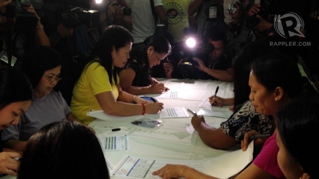SAMPLE BALLOTS. Ten voters fill out ballots that they will use to test the PCOS. Photo by Paterno Esmaquel II