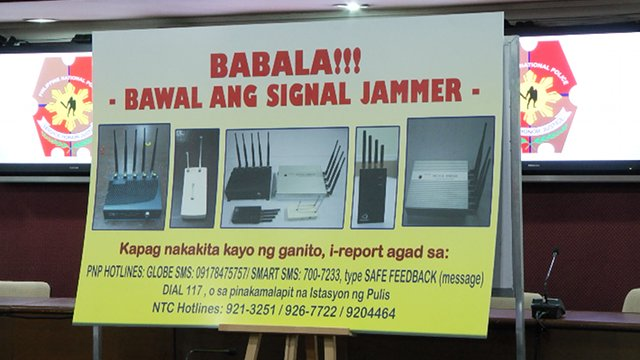 WARNING. A poster asking the public to report sightings of signal jammers, including the numbers they can call or text. Photo by Rappler/Naoki Mengua