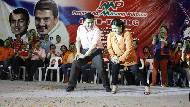 CAMPAIGN THEME. Sen Jinggoy Estrada performs the Gangnam Style with celebrity Marissa Sanchez at the PMP oath-taking. Photo from former President Estrada's Facebook page
