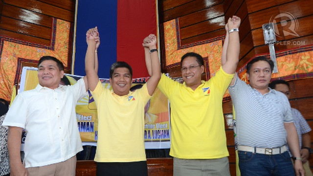 Regional board of canvassers chief Atty. Ray Sumalipao and ARMM COMELEC regional election director and state prosecutor Ramy Guiling proclaim Mujiv Hataman(2-L) and  Haroun Al Rashid Lucman (2-R) as governor and vice governor of the Autonomous Region in Muslim Mindanao. Photo by Ritchie Tono
