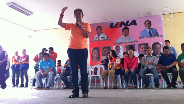'REMEMBER ME.' Nancy Binay does the high-five to help voters in Mabalacat, Pampanga remember her ballot number. Photo by Ayee Macaraig.