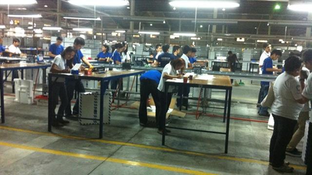 MACHINE INSPECTORS. PCOS machines undergo scrutiny at Smartmatic's warehouse in Cabuyao, Laguna. File photo by Reynaldo Santos Jr