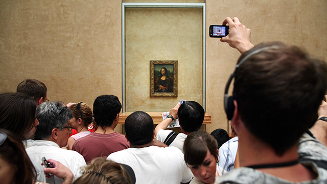 Taking pictures to remember may help you forget