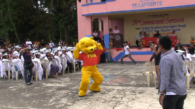 SURPRISE GUEST. Winnie the Pooh joins the festivities, courtesy of 3rd District Rep Luis Villafuerte Sr. Photo by RAPPLER