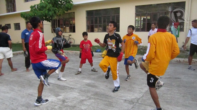 PRACTICE MAKES PERFECT. Region 1 athletes training in the Pangasinan National High School, their billeting station. Isabel Rodriguez,