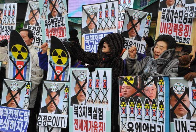 NO TO NUKE TEST. Activists from an anti-North Korea civic group shout slogans during a protest against a North Korean nuclear test in Seoul on February 12. Photo by AFP/Kim Jae-Hwan
