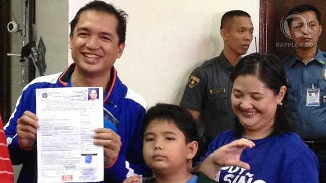 WET LOOK. Bayan Muna Rep Teddy Casiño files his certificate of candidacy accompanied by his family at the Comelec office in Manila. Photo by Paterno Esmaquel II